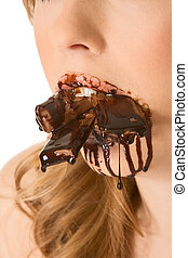 Sweets lover - mouth stuffed with chocolates - Close up of...