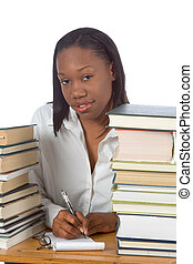 Studying - African-American female by piles of books