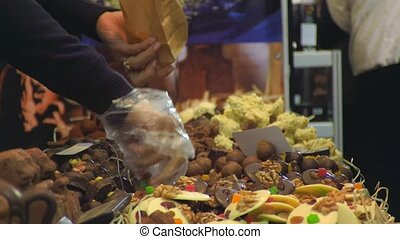 Buying sweets on the market