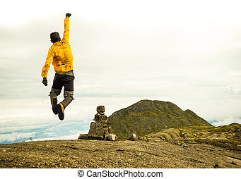 Motivated Man Jumping Celebrating Success with the view of a...
