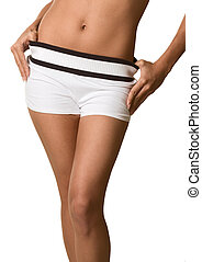 Torso and hips of woman in white shorts bare belly -...
