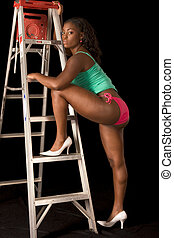 Sexy African-American woman in lingerie by ladder