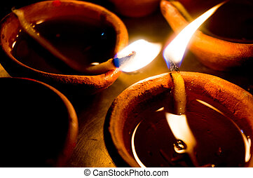 Earthen ware pots with cotton and oil to light - Earthenware...