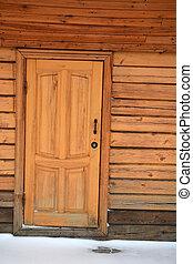 Wooden door of the bath house