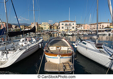 Sailboats and fishing boats at Porto di Bardolino harbor on...
