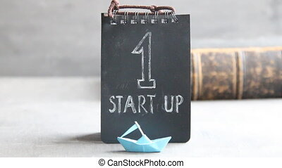 Startup tag and paper boat - Startup Business, vintage...