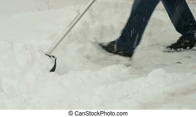 Man cleaning snow with shovel - Man cleaning the house yard...