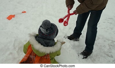 Grandfather and grandson playing outdoor in winter -...