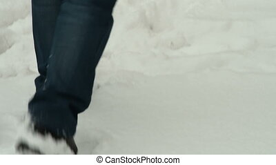 Man walking on fresh snow