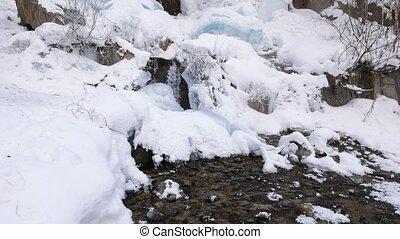Creek in the ice. UltraHD (4K)