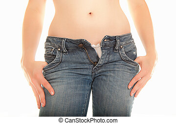 Young woman with open jeans