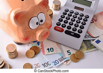 Savings and accounting with piggy bank money and calculator elevated