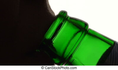 Girl drinking from a beer bottle - Girl drinks from the...