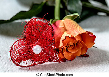 Rose with heart decoration