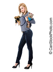 Pretty young blonde posing with two dogs