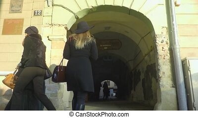 walking through arched tunnel in the house - women who...