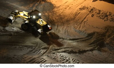 Snow removal machine at night - High angle shot of snow plow...