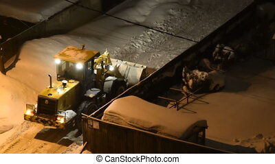 Night view of working snow plow - Snow plow cleaning small...