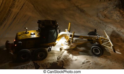 Working snow plow on night road - Snowplow truck cleaning...