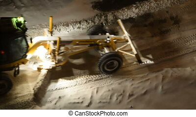 Working snow plow at night - Snow removal machine cleaning...