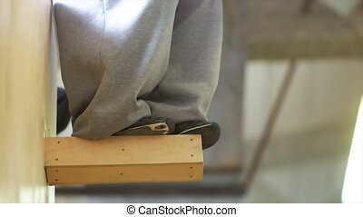 Parkour Trainee Jumping from Wooden Beam - Young caucasian...