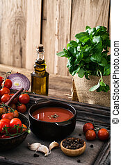 Tomato soup. Homemade tomato soup with tomatoes, herbs and...