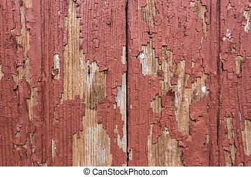 Red rustic reclaimed wooden wall background. Close up.