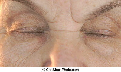 Old woman's face with disturbing look of face