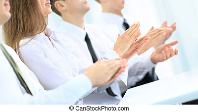 Happy business group of people clapping hands during a...