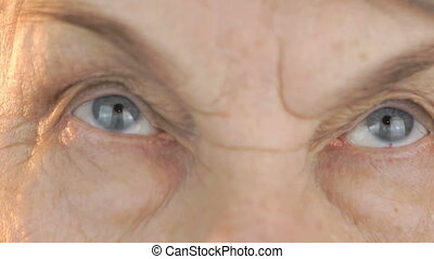 Old woman looks the eyes in different directions - Old woman...