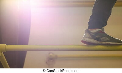 Man Walking and Balancing on the Bar - Adult parkourist...