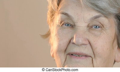 Portrait of a senior smiling woman. Close up