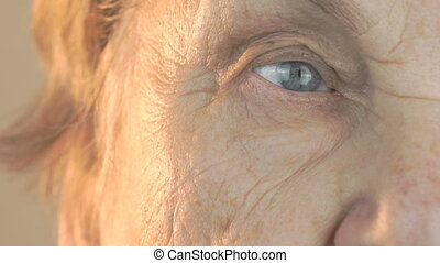 Elderly woman's face with disturbing look of face. Close up