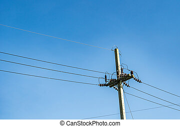 Power lines with pylon on blue sky