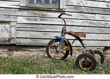 Rusty Trike - An old tricycle on a farm