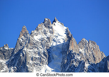 Mont-Blanc massif rock and snow - Close up ot the rock and...