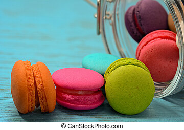 French delicious dessert macaroons on wooden table