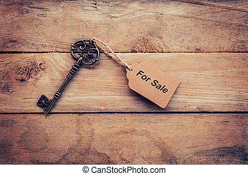 Business concept - Old key vintage on wood with tag For...