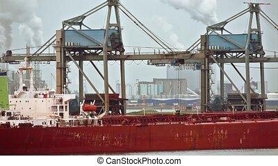 Unloading a huge ship - Unloading a huge bulk ore carrier...