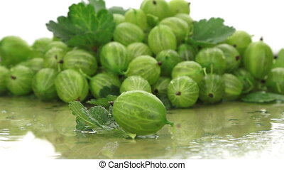 Closeup gooseberries on a background made of gooseberry....