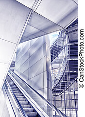 Staircase escalator in modern business center, in the...
