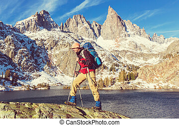Man with hiking equipment walking in Sierra Nevada...