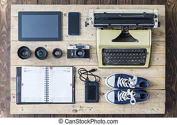 Journalist equipment on an old wooden floor
