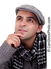 Portrait of a young man thinking, in autumn/winter clothes, isolated on white. Studio shot