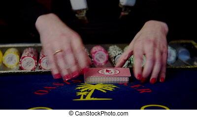 Casino, poker: Dealer shuffles the poker cards.