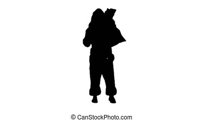 Silhouette Santa claus with a sack of gifts dance....