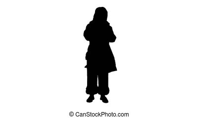 Silhouette Real Santa Claus carrying big bag full of gifts
