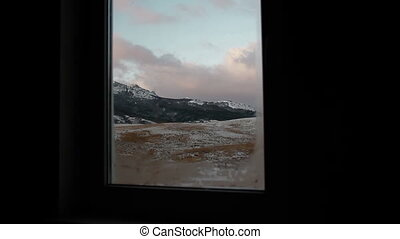 view of the snow-covered mountains through the window.