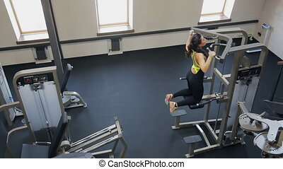 Woman fitness instructor catching up on trainer inside gym....