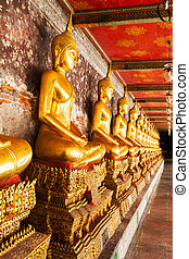 Yellow golden buddha at Wat Suthat Thepwararam, Bangkok,...